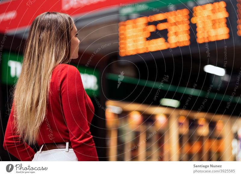 Girl in Train Station back view looking blonde faceless train station woman young copyspace panel information panel casual model destination travel girl female