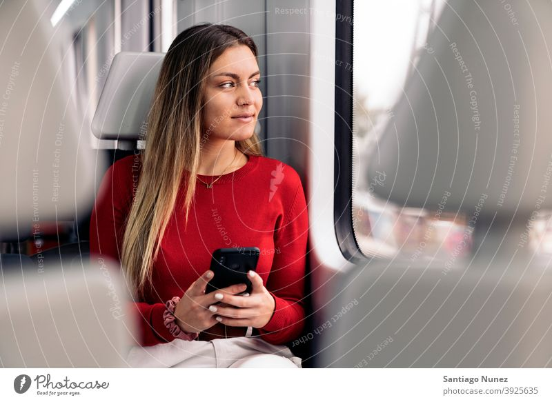 Young Blonde Girl in Train train traveling girl portrait young 20s front view blonde pretty phone using phone cellphone caucasian looking standing woman female