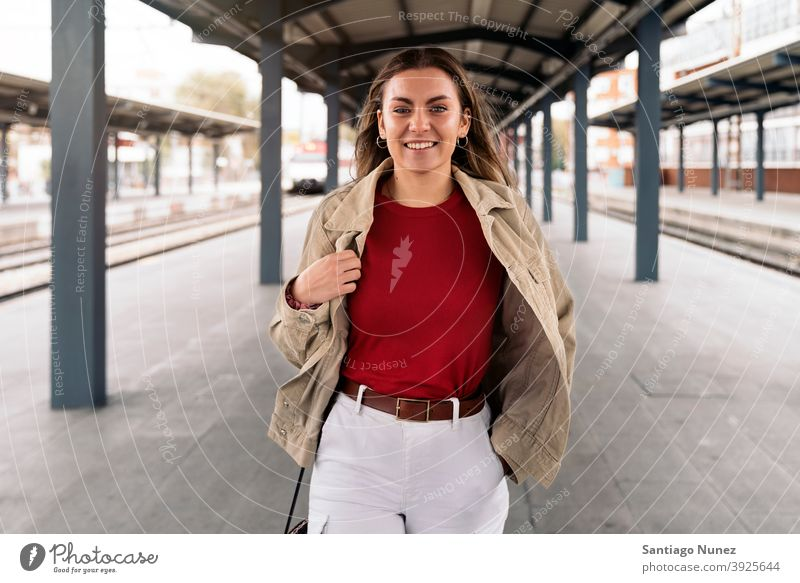 Happy Woman Portrait walking portrait looking at camera platform standing pretty woman girl young female outside outdoors front view posing one person alone