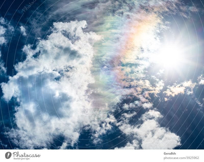 blue sky white clouds sun and rainbow air atmosphere azure background climate cloudiness cloudscape cloudy color cumulus day environment fluffy front haze