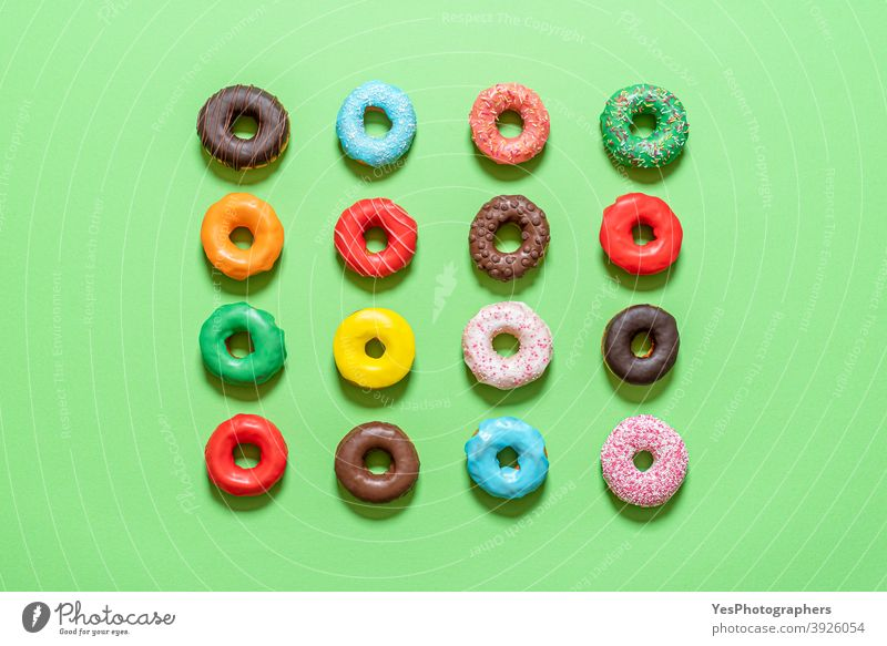 Chocolate donuts top view. Multicolored glazed doughnuts above view aligned assorted background baked bakery blue breakfast cake calories chocolate colorful