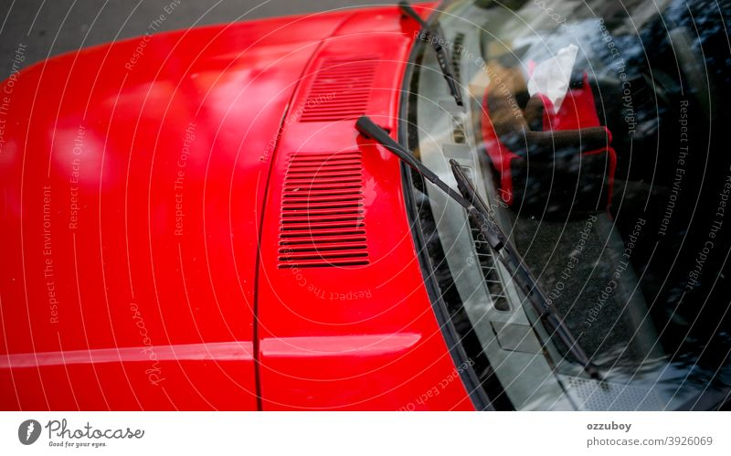 wiper on red car transportation glass outdoors horizontal automobile part vehicle windshield window windscreen driving hood luxury shiny abstract mirror