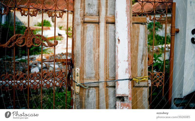 rustic door on fence Door Rustic Damage Fence Entrance Front door Door handle Wooden door Colour photo Closed Structures and shapes Detail door handle Old