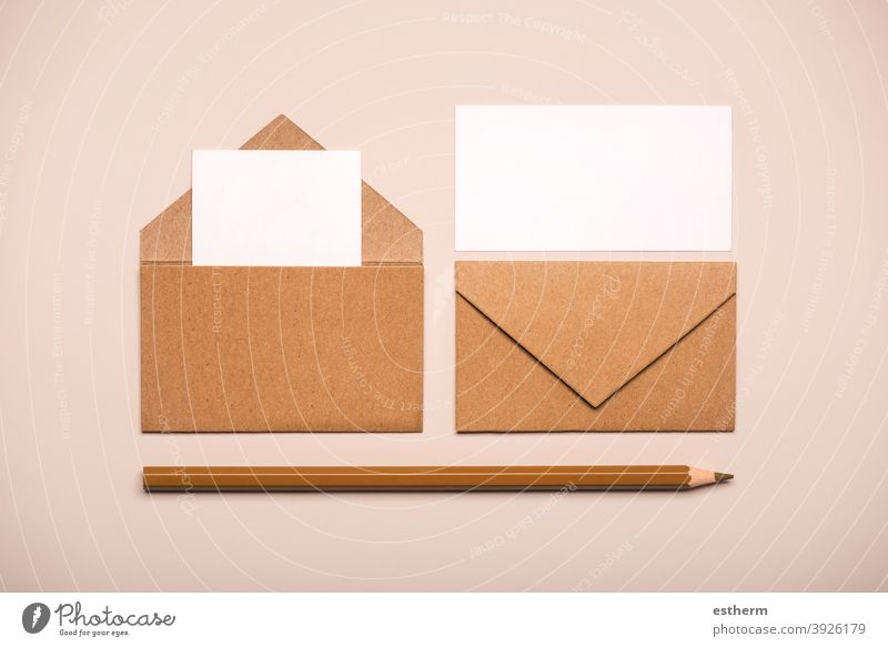 Brown paper envelopes with white cards and brown pencil letter message copyspace copy space mock-up package send cover mock up flyer page post communication