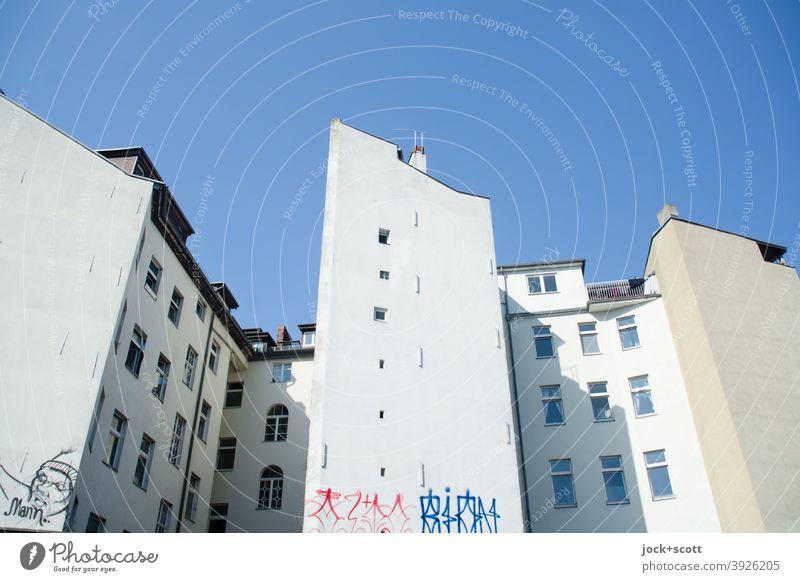 Openings in external fire wall Town house (City: Block of flats) Fire wall Cloudless sky Facade Backyard Symmetry Authentic Architecture Graffiti Street art