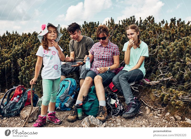Family having break and eating snacks during trip in mountains. Family actively spending summer vacation together activity adventure female freedom fun green