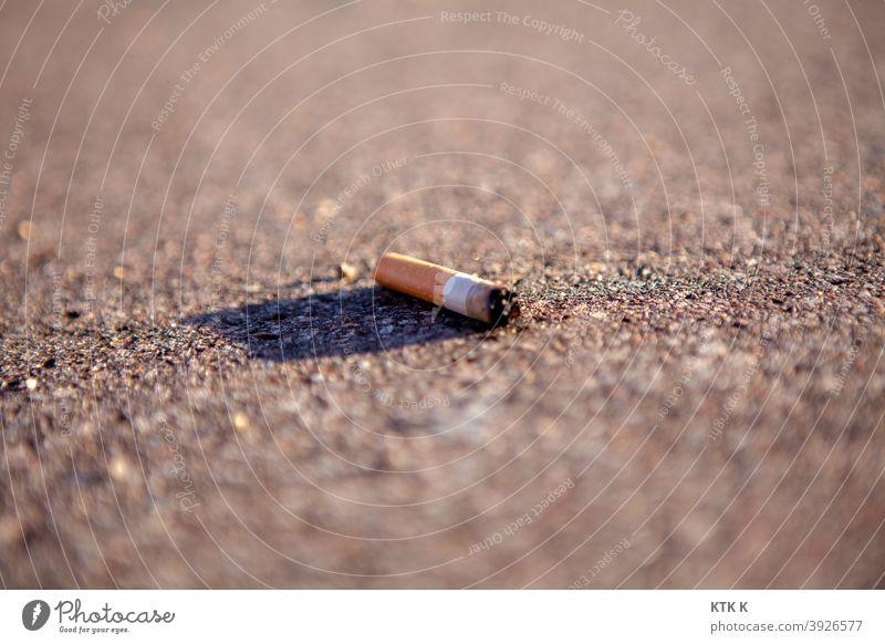 un mégot - cigarette butt Cigarette Cigarette Butt Filter-tipped cigarette enjoyment luxury food Nicotine Dependence Remainder Addiction jettisoned Unhealthy