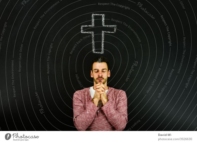 believing man prays under a cross Religion and faith Crucifix Hope God Church Symbols and metaphors Christ believe