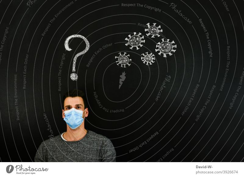 Coronavirus - Man thinks about Corona coronavirus mutation Think thoughts ? Question mark Virus Future Fear Fear of the future pandemic Mask Respirator mask
