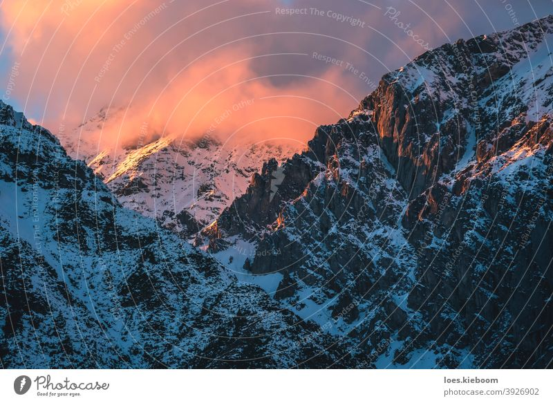 Sunset in rocky mountains with sunlit cloud of Austrian Alps in Mieming, Tyrol, Austria winter snow sunset austria landscape tyrol background alps europe season