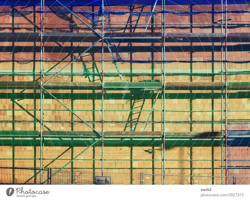 Sprightly Scaffold Building House (Residential Structure) Scaffolding Town Construction site Detail Exterior shot Contrast Sunlight Shadow Light Firm Long shot
