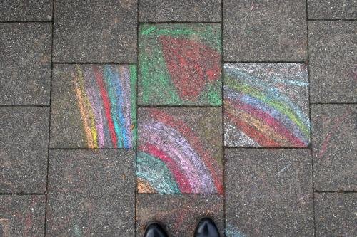 view of chalk painted pavement slabs Rainbow painting Painted children's chalk crayon street chalk street-painting chalk Chalk Sidewalk off Street Ground