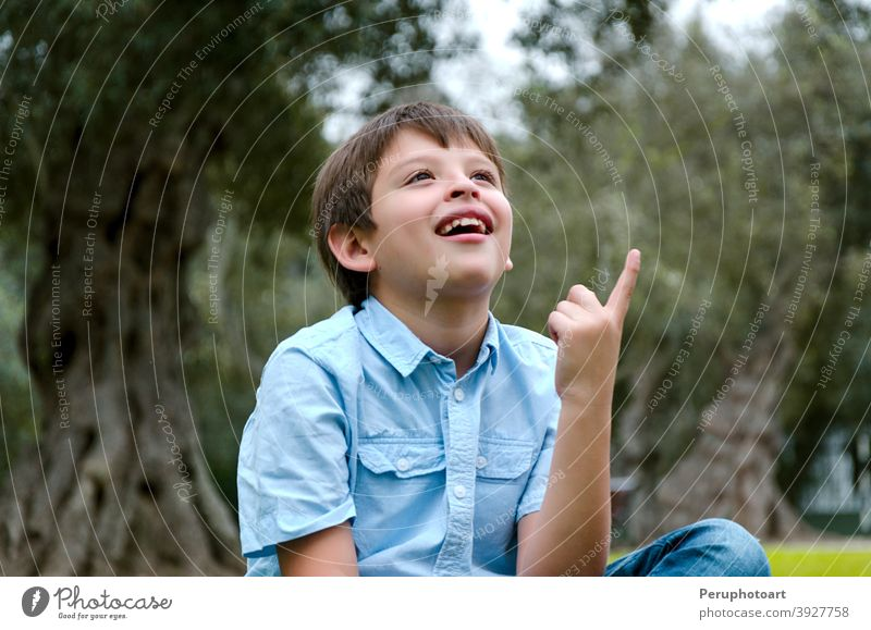 Portrait child with blond hair has an idea, pointing with finger up man happy male person boy young one people face guy hand handsome expression creativity