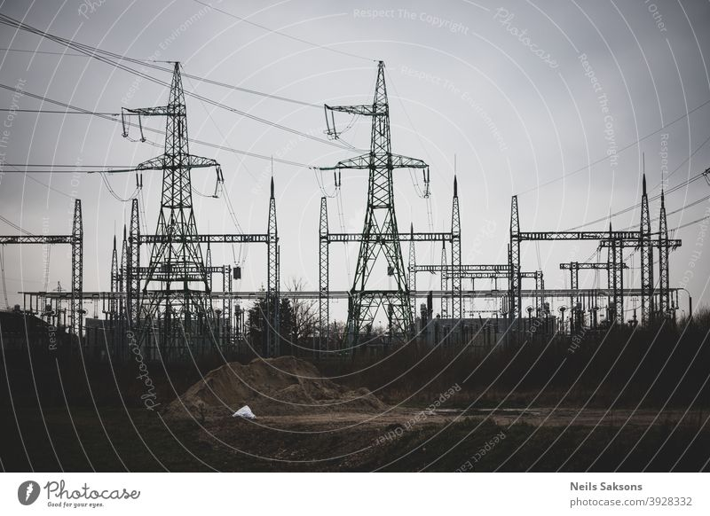 high voltage post, high voltage tower cloudy sky background electric power power grid electric utility power station utilities electricity blue cable