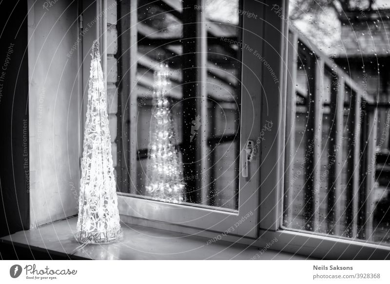 Christmas lights in window. Tree shape Christmas decoration Pyramid Christmas & Advent Christmas fairy lights Fairy lights Illuminate reflection
