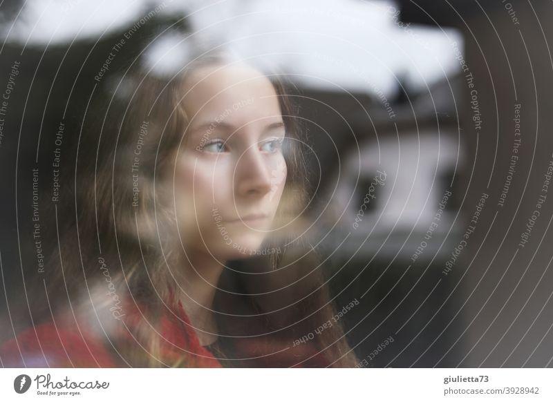 Portrait of a sad teenage girl at the window, longing, heartbreak portrait Girl Woman Love Future Window pane Puberty View from a window Twilight Feminine