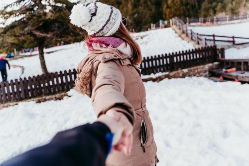 follow me. happy woman and man holding hands. pov. winter season at the mountain. Love concept smile laugh snow love boyfriend girlfriend valentines sunny sport