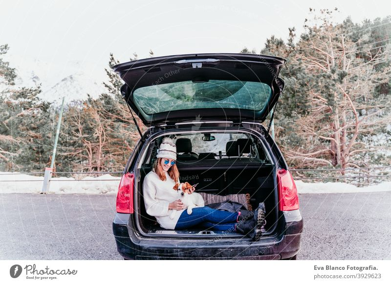 Woman and dog in car in the snow, winter time nature together season wanderlust beauty cute active togetherness friends day outside jack russell relaxation hug