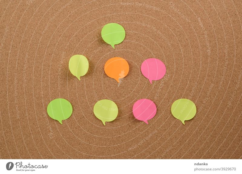 multicolored round sticks are glued to the brown cork board adhesive announcement attached backdrop background billboard blank bulletin business colorful