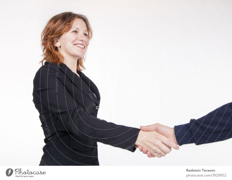 business woman shaking hands with a colleague people agreement office handshake team happy businesswoman male female work professional person teamwork greeting