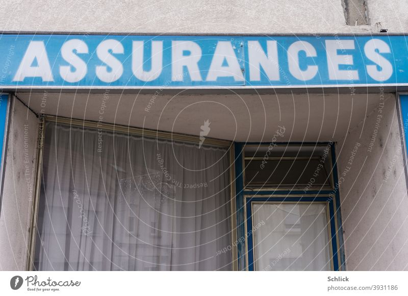 Sign Assurances white on blue over an old insurance agency around 1950 sign Insurance French Old Insurance Agency Blue tone Christmas Closed vintage Shop window