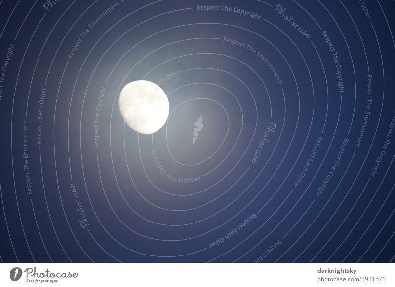 Three-quarter full moon in December with a veil of clouds at the evening blue hour. Moon Sky Clouds Celestial bodies and the universe Moonlight Blue Universe