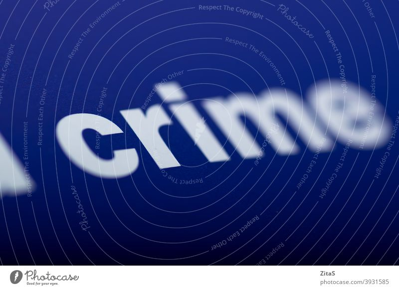 Crime word typed against a blue background crime closeup book macro text page