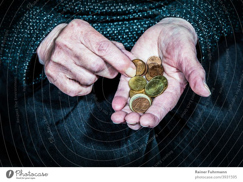 an elderly woman holds in her hands few coins Old wrinkled Woman Pensioners annuity Poverty Coins Money Hard cash Save Thriftiness Investment Loose change Euro