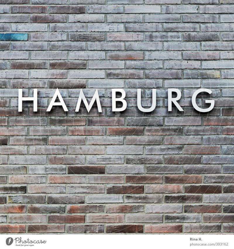 HAMBURG Wall (barrier) Wall (building) Facade Stone Metal Characters Identity Hamburg Brick Typography Colour photo Deserted Copy Space top Copy Space bottom