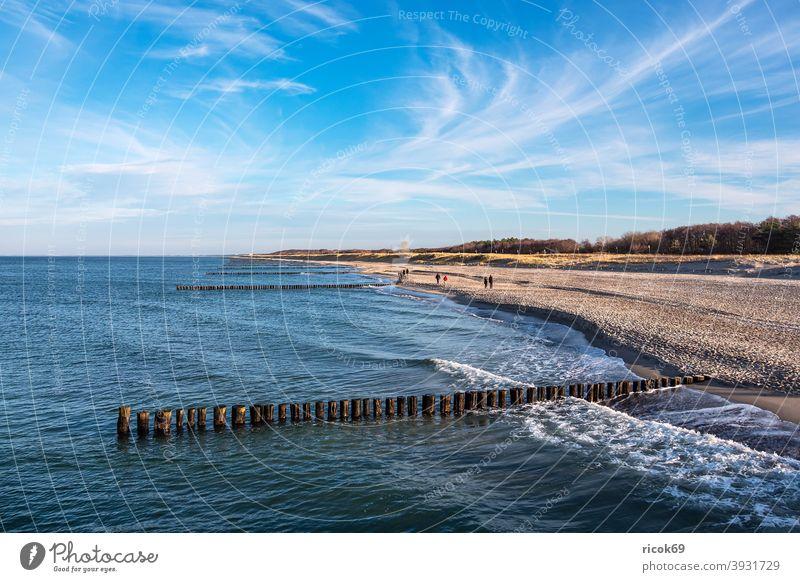 Groynes at the Baltic Sea coast in Graal-Müritz graal müritz Baltic coast Ocean Beach groynes duene Marram grass Waves Water Sky Clouds Blue