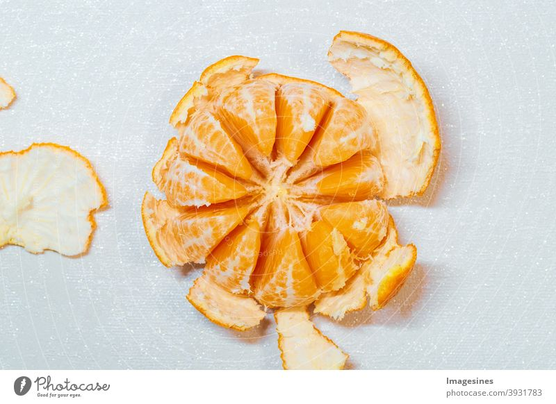 Ripe juicy peeled orange tangerine, clementine localized on light background, top view. Orange peel, orange peel. Food food photography Food photograph