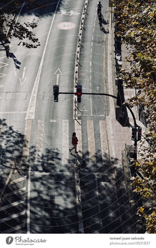woman on the crosswalk. Bilbao city, Spain tourist tourism person people human pedestrian shadow silhouette street outdoors visit visiting action walking