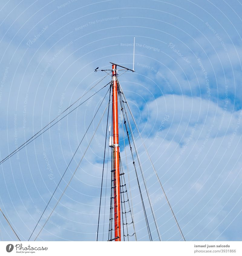 sailboat wooden mats and blue sky ship mast sailing rigging vessel sea seaport tall nautical transportation rope masts ropes old travel marine water wind yacht