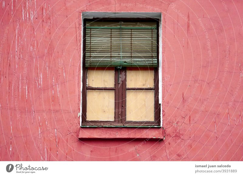 window on the red facade of the house, architecture in Bilbao city Spain building exterior home street outdoors color colorful structure construction wall