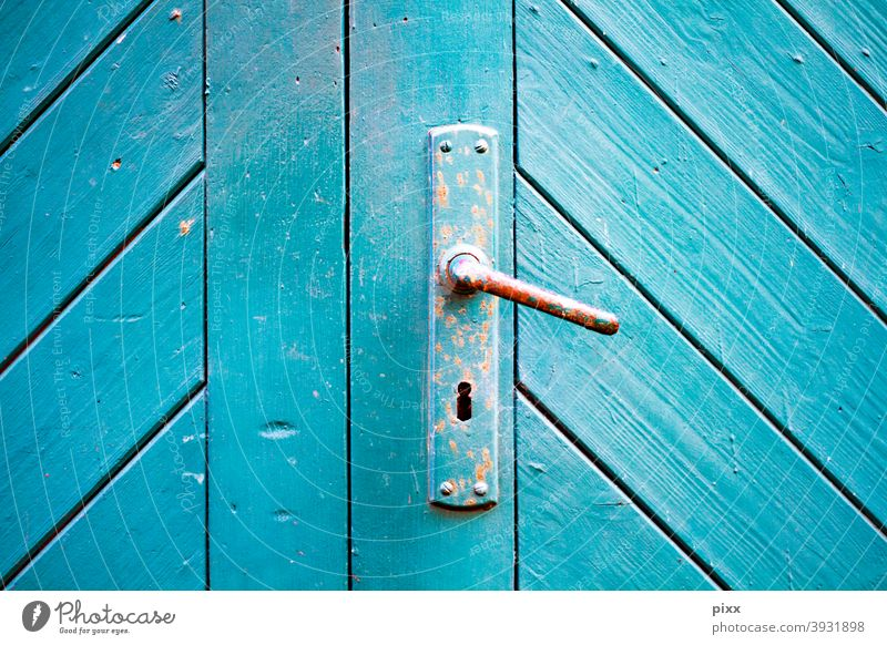 Wooden gate turquoise with door handle Closed Turquoise Blue Keyhole Front door Entrance Goal locked caginess Rust rusty Diagonal slats Colour Redecorate