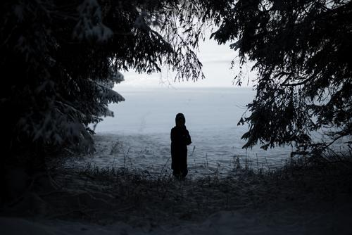 Child at clearing in winter Snow Animal tracks Winter Powder snow White Walking Hiking outdoor Forest Cold pass somber Swabian Jura Winter forest snow forest