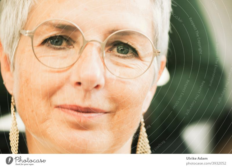 UT HH 2019|Sympathetic with green eyes Forward Front view portrait Shallow depth of field Neutral Background Isolated Image Close-up Exterior shot Meditative