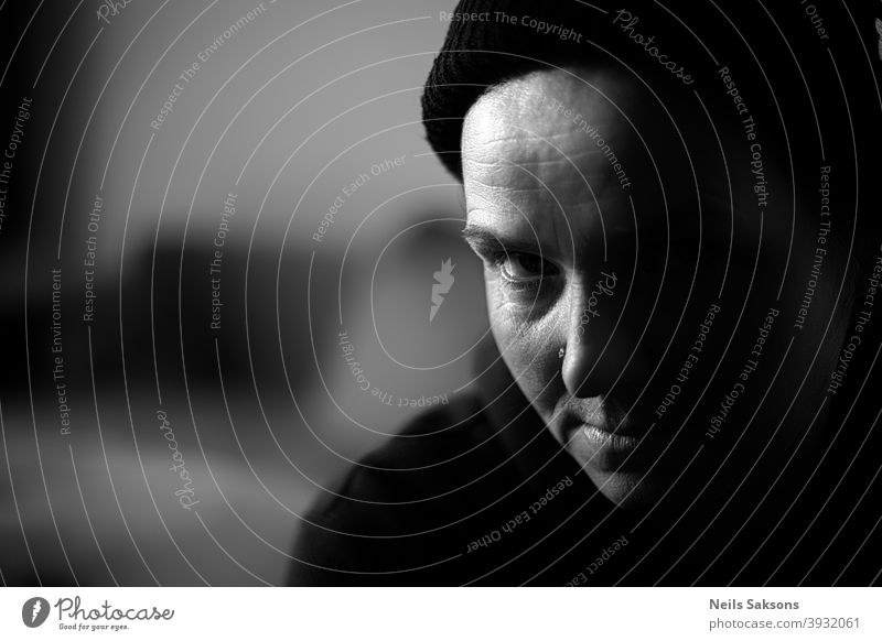 portrait of a woman in black beanie Portrait photograph Looking into the camera look look into the camera Face Black & white photo Feminine Human being Woman