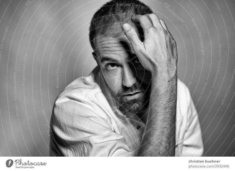 contemplative portrait black and white Man 30 years Hand Interesting Meditative Earnest inquisitorial Facial hair Eyebrow Frontal