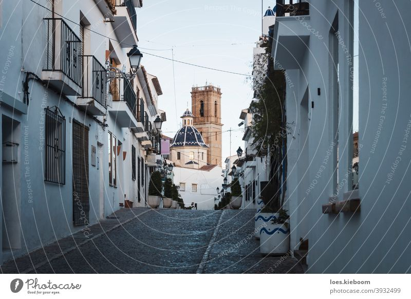 Old town of Altea with cobblestoned steet and view on blue domed cathedral, Altea, Costa Blanca, Spain altea spain church building tourism architecture vacation
