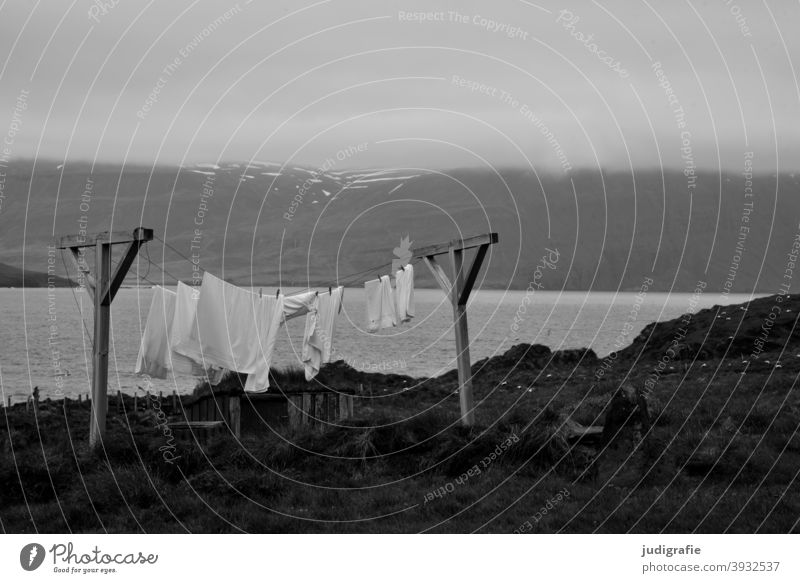 Laundry dries on Icelandic fjord clothesline Washing Cotheshorse Fjord Landscape Washing day Living or residing Photos of everyday life Clothing Fresh Dry