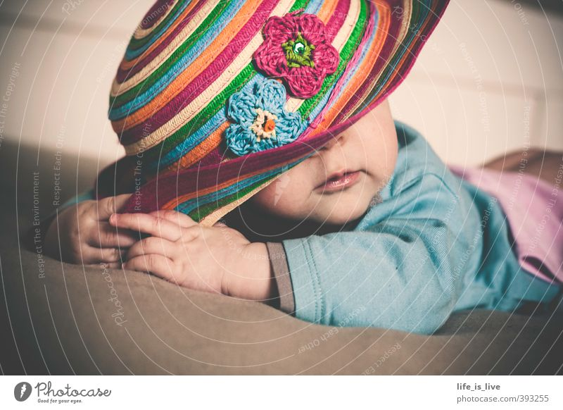 in pose Beautiful Feminine Baby 1 Human being 0 - 12 months Lie Cute Hat Subdued colour Interior shot Portrait photograph