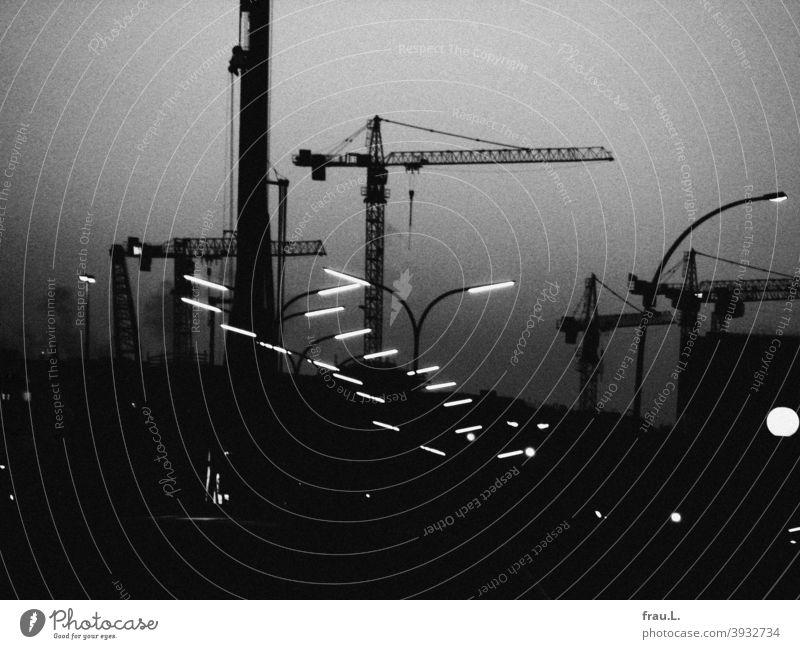 Nocturnal railway system Town Night Evening Lamp Lantern Crane cranes Traffic infrastructure Lighting Dark Transport