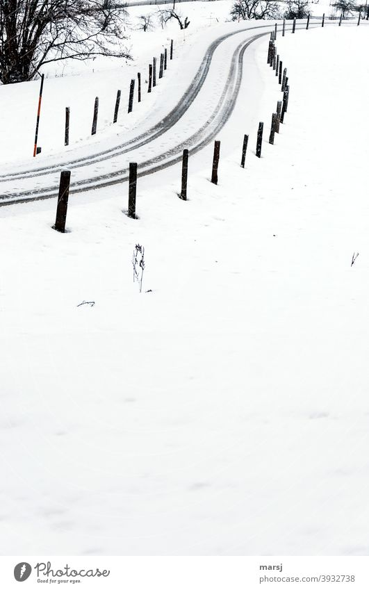 If it weren't for the track posts, drivers might not have found the S-shaped, snow-covered road at all snowy road Street Winter vacation Snow freezing cold