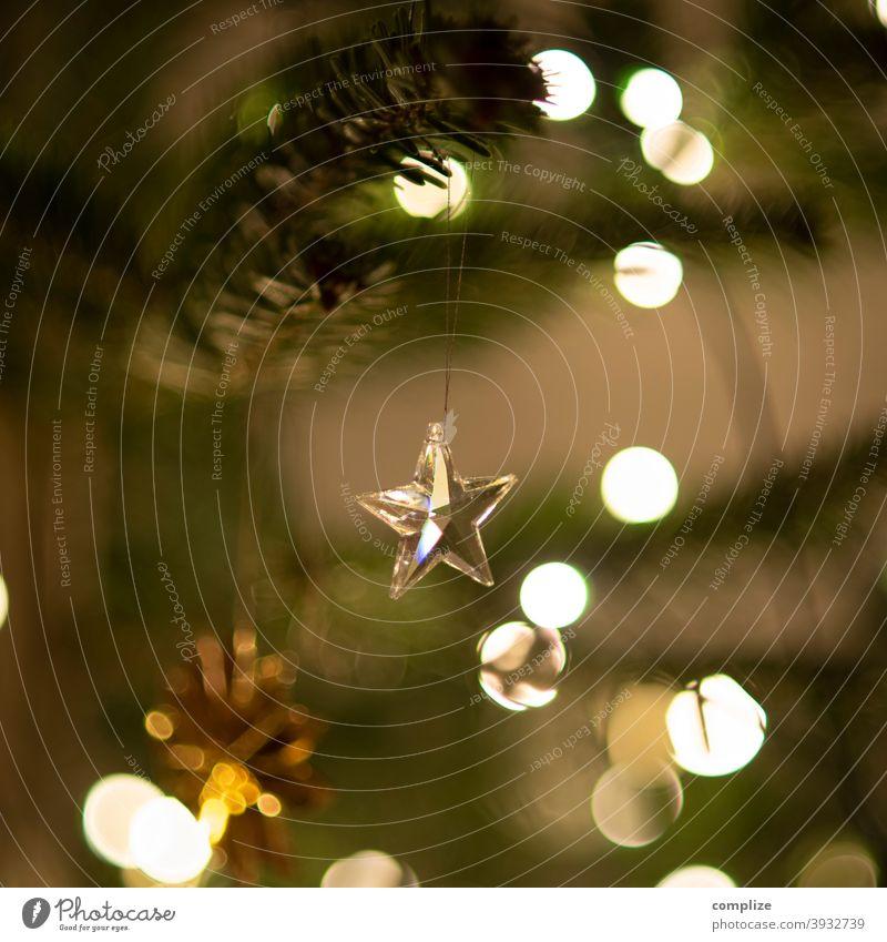 Glass star on Christmas tree Angel Decoration glossy Fir tree Fir branch needles Glitter Ball Christmas tree decorations Fairy lights embellish