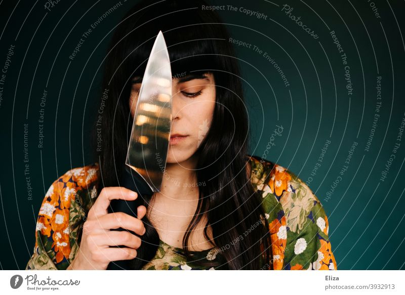 Woman with knife Knives Force suicide youthful sad desperate Problem tart Emotions in thought Melancholy Earnest depression Suicide suicidal thoughts