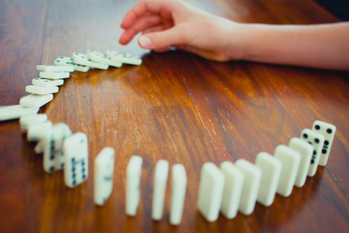 Domino the parlour game Playing Colour photo Tumble down Toys Leisure and hobbies Fingers Success Hand Human being Joy Movement Day Chain reaction Parenting