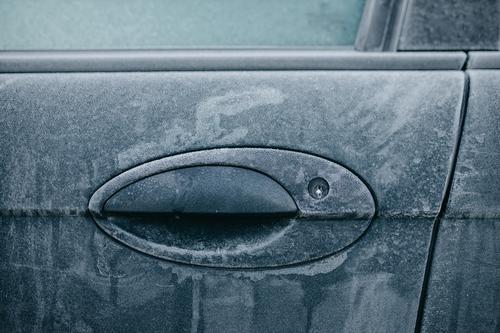 Frosty car lock Door Winter Car Cold Frozen Freeze Car Window Ice Car door Exterior shot Morning Snow Glass Blue Contrast Colour photo Deserted Window pane