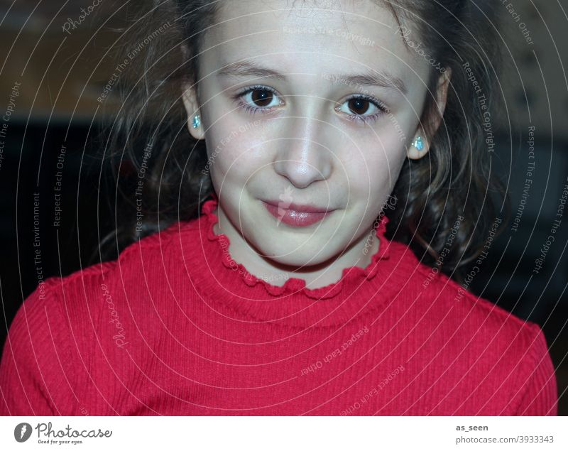 Girl in red sweater 8 - 13 years brown hair brown eyes direct look Smiling Self-confident cheerful flashed portrait pretty Human being Colour photo Feminine
