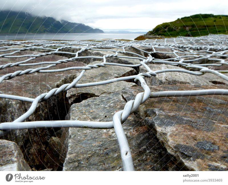 shoreline stabilization... Bank reinforcement coastal protection Stone boulders Wire netting fence Fastening fix Ocean bank Tide Fjord Nature Landscape